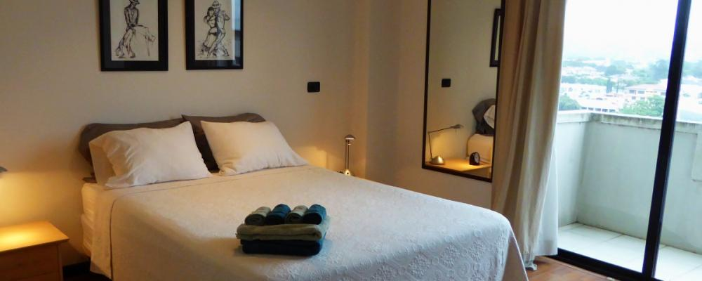 Master bedroom with en suite bathroom and balcony