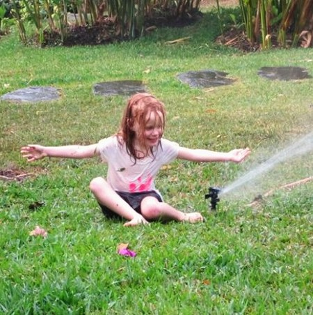 Scarlet in a Sprinkler